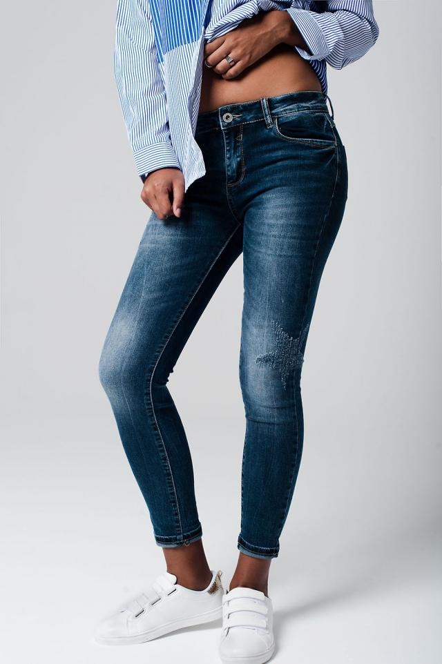jeans  cintura media com estrelas desgastadas