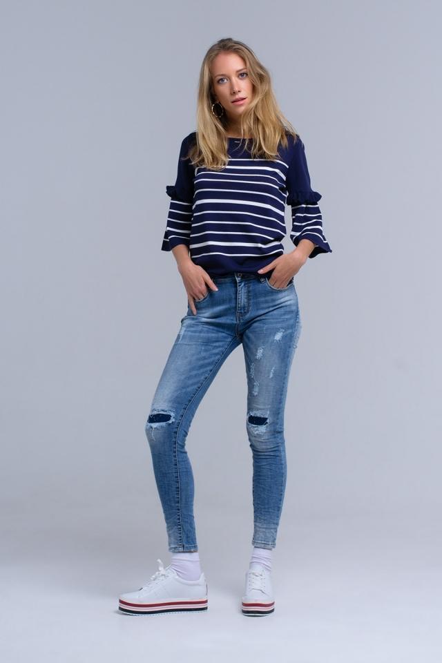 Calças jeans skinny com rips