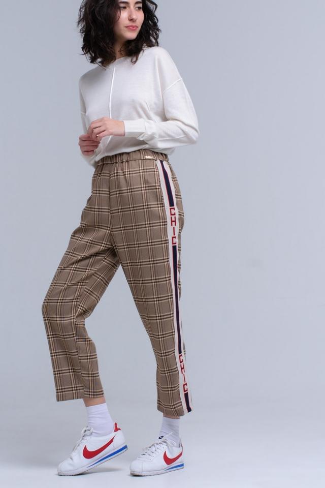 Calças de padrão tartan marrom