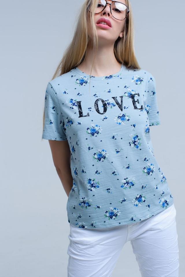 T-shirt azul com estampado floral e logótipo
