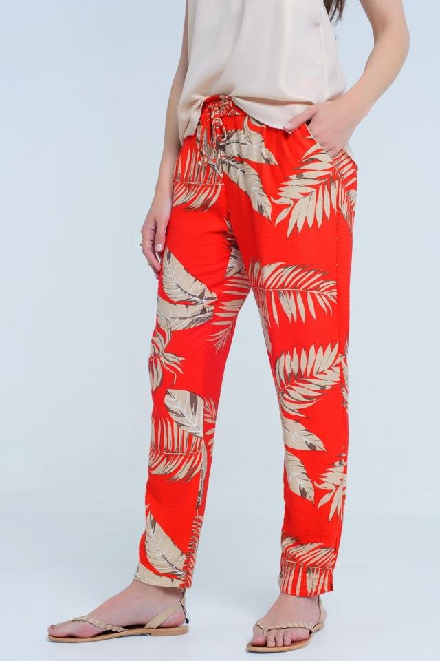 Calça vermelha com estampa de folha
