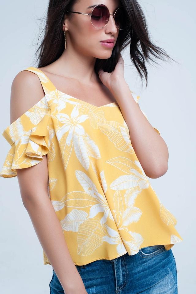 Top amarela da flor e detalhe dos plissados