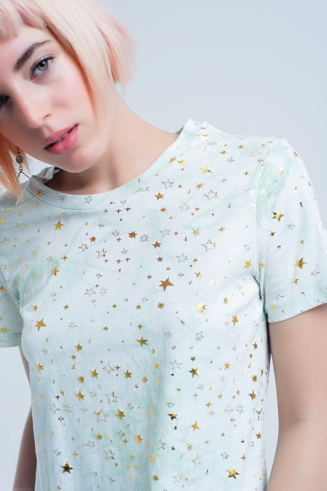 T-shirt verde efeito desbotado com estrelas douradas