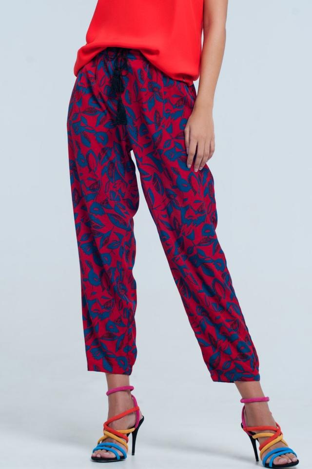 Calças de perna larga com estampa floral em vermelho