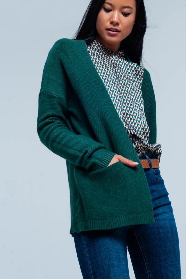 Casaco verde com bolsos