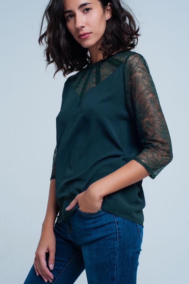 Blusa verde com detalhe de laço