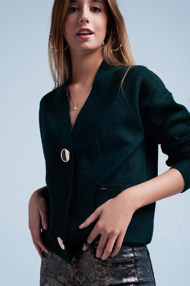 Cardigan verde escuro com botões dourados