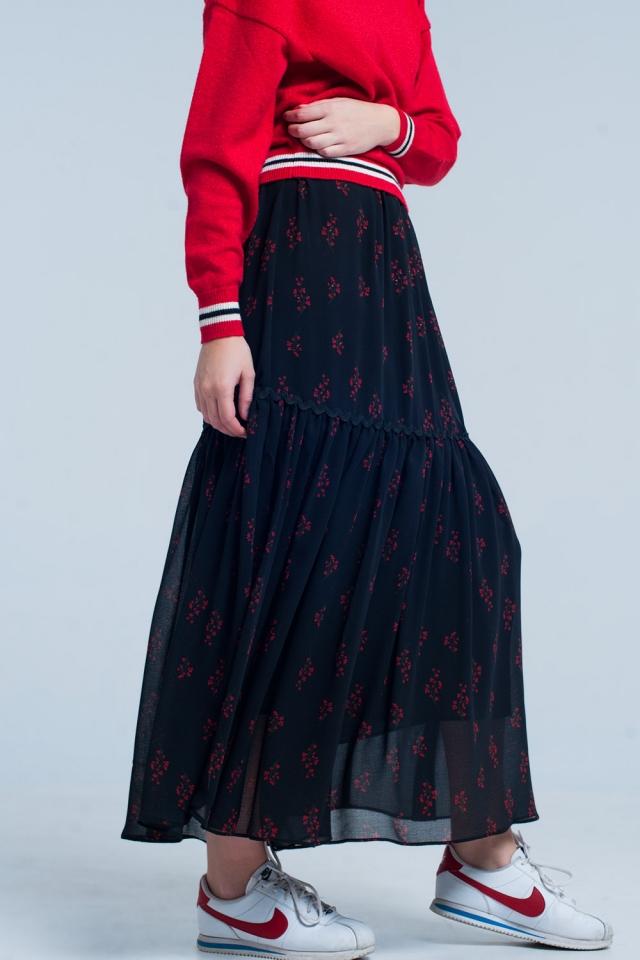 saia longa preta com estampado floral