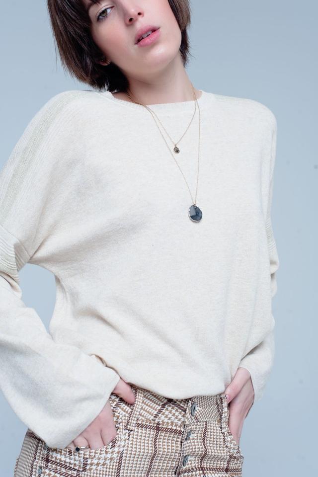 Camisola de malha fina bege com detalhes de brilho