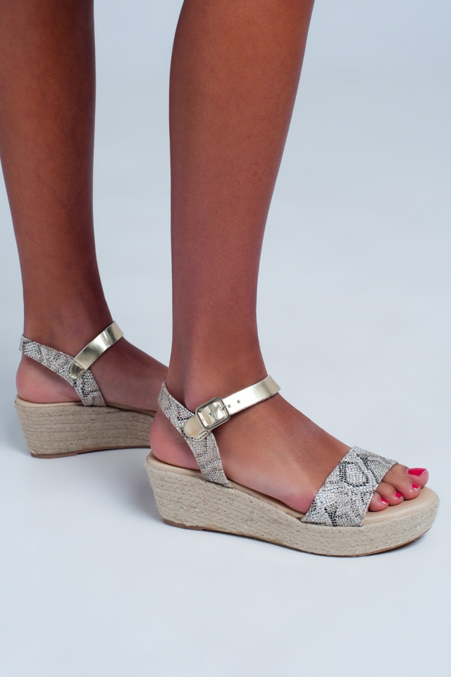 Espasrille sandals with snake print