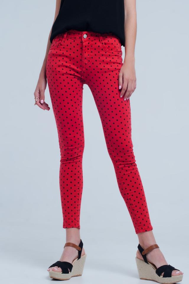 Red skinny jeans in polka dot print