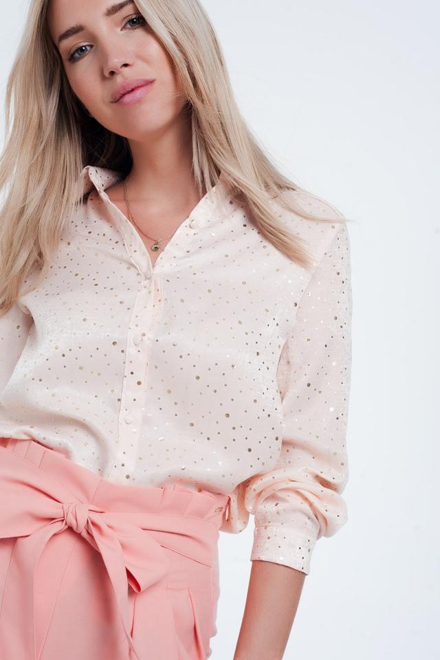 Blusa rosa de manga comprida com design de bolinhas de ouro