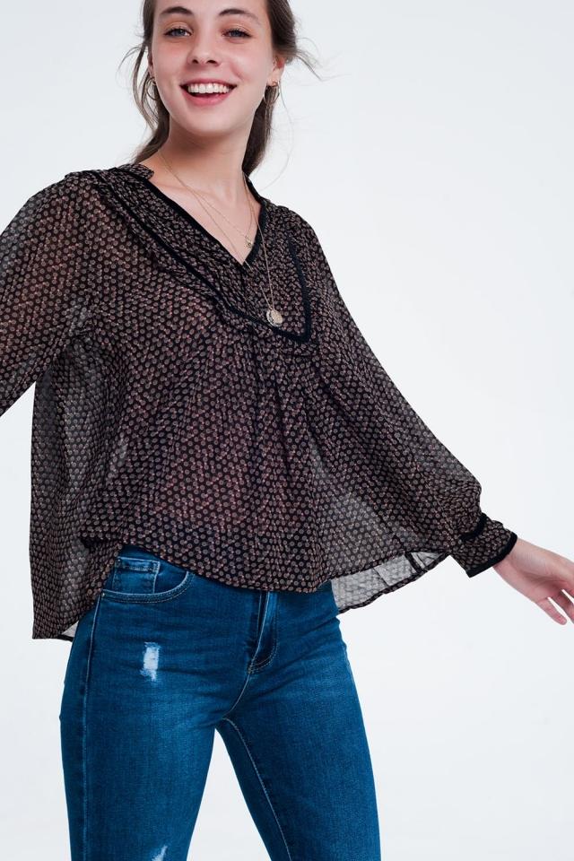 Design impresso em preto tipo túnica top
