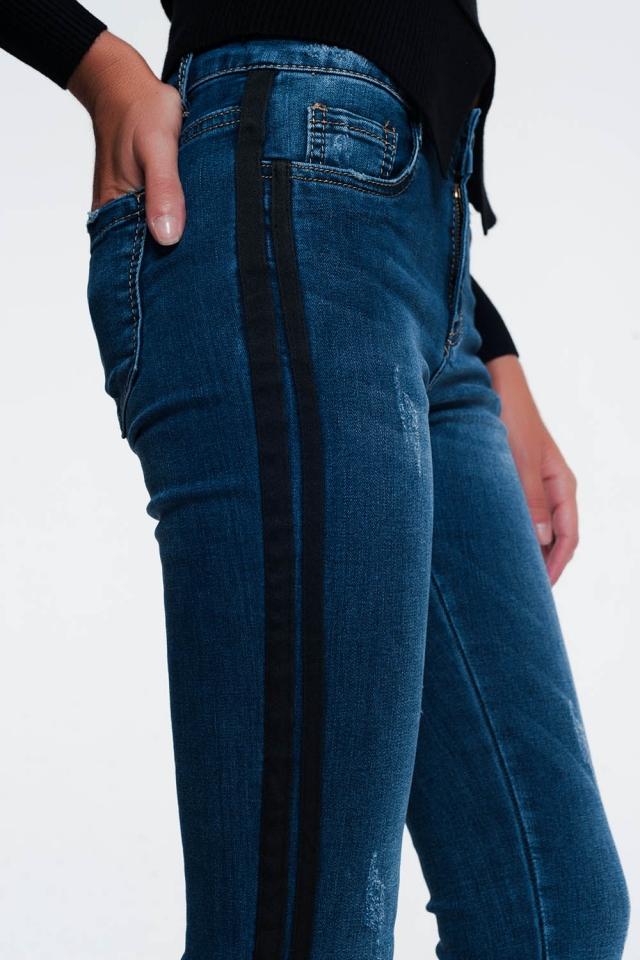 Calças de ganga com design desgastado e listra lateral preta