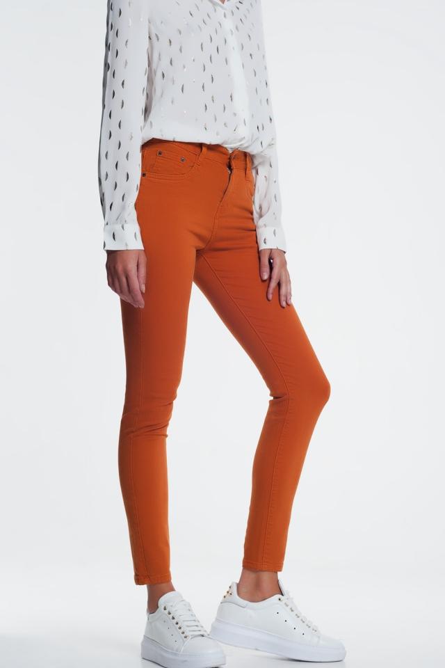 Calças de ganga laranja apertada
