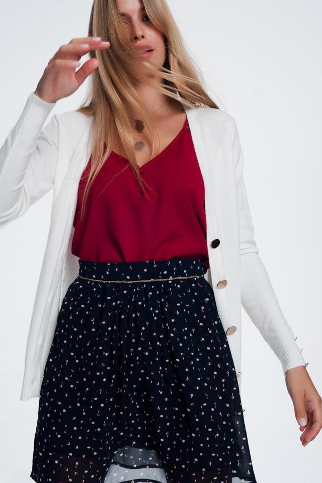 Casaco de lã branco com detalhe de botão