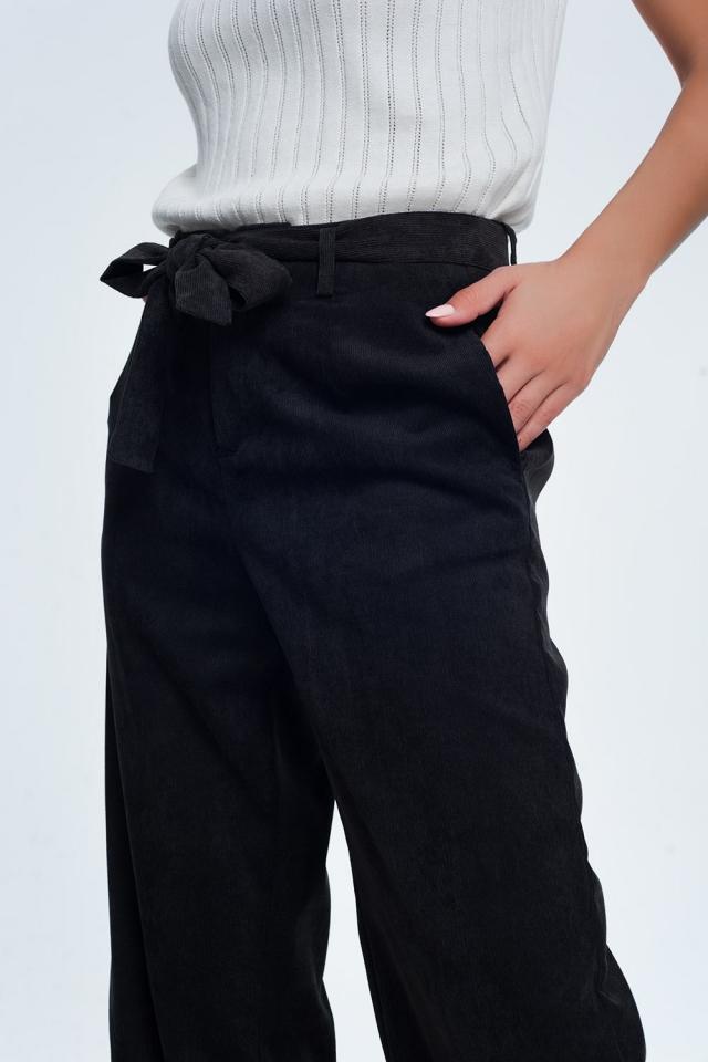 Calças de veludo preto