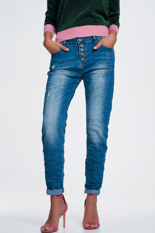 Jeans with exposed buttons fly