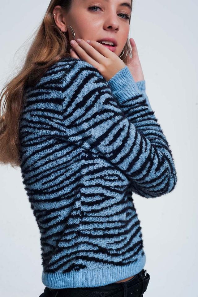 Camisola azul com estampa de tigre em todo o vestuário