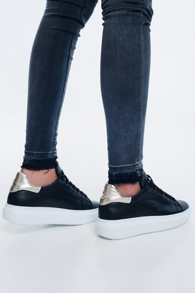 Black sneaker with golden detail