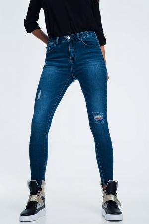 Calça de ganga azul rasgada