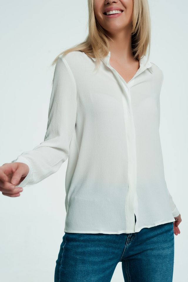 Shirt with long sleeves in cream