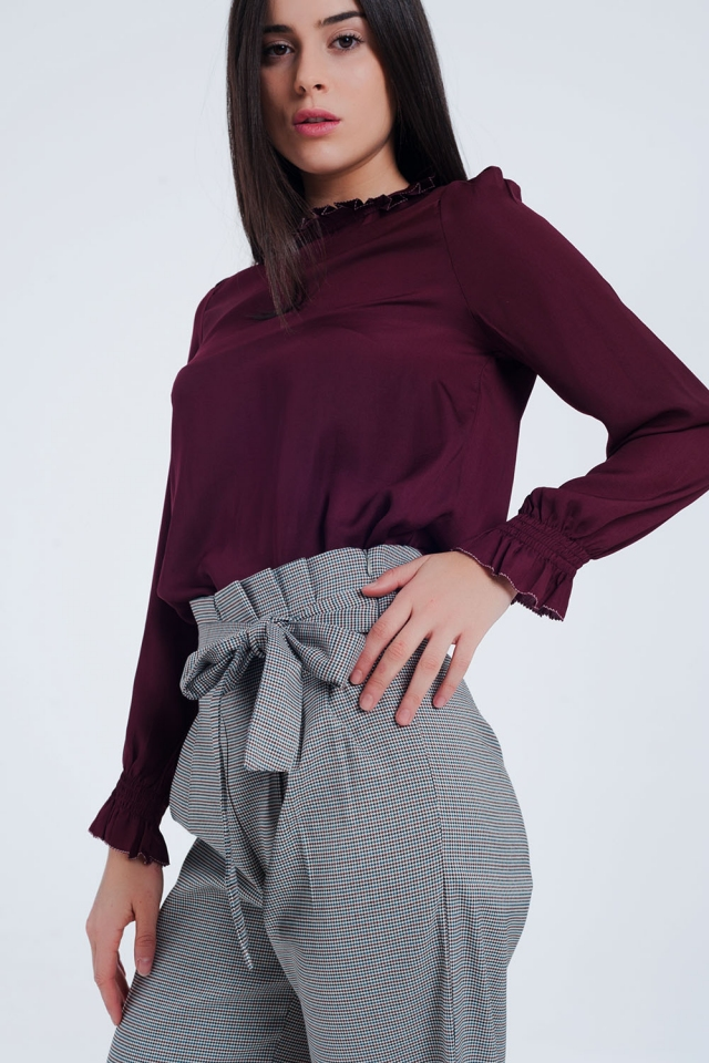 Maroon shirt with neck and sleeve detailed ends