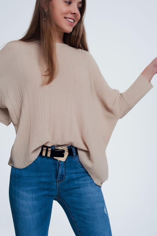 Camisola de malha fina feita de fio metálico bege