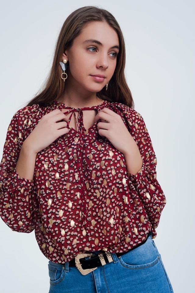 Blusa laço vermelho com bolinhas de ouro em relevo
