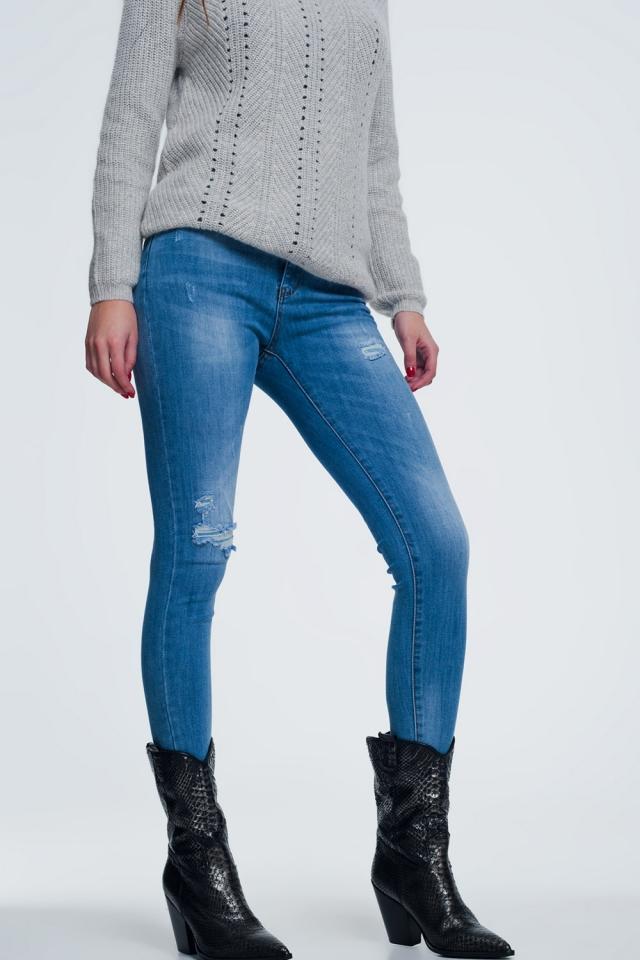 calças de ganga envelhecido azul médio