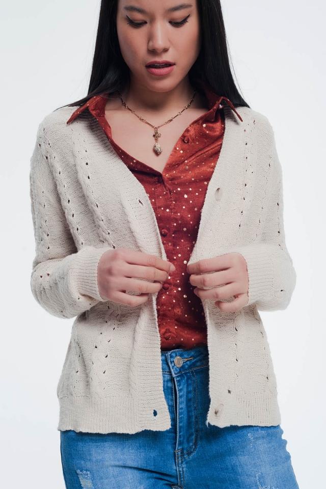 Casaco de malha texturizado com design bege abotoado