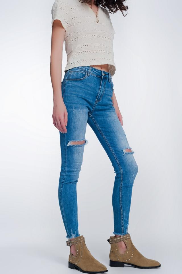 Calças de ganga super skinny com buracos nos joelhos