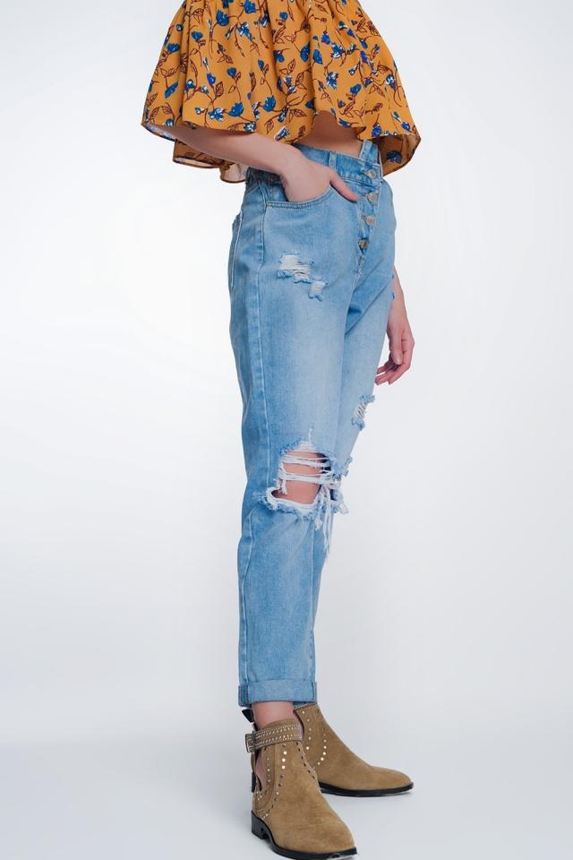 Calças de ganga mom de cintura alta con botón delante