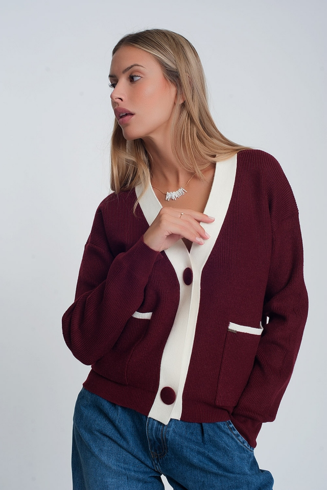 Maroon cardigan with white details and two buttons