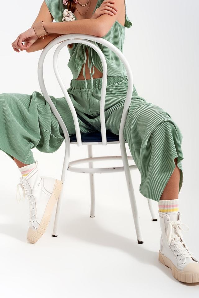 Calças de perna larga relaxadas em cor turquesa plissada
