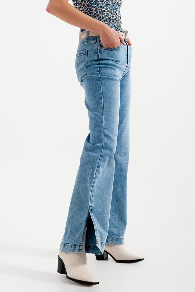Calças de ganga de cintura alta com fendas laterais em azul lavado