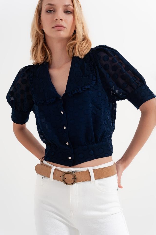 Blusa azul marinho Polka dot com colarinho de babete e botões embelezados