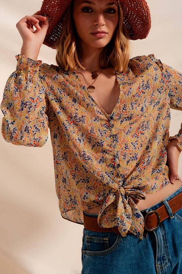 Blusa com rufos florais e metálicos verdes