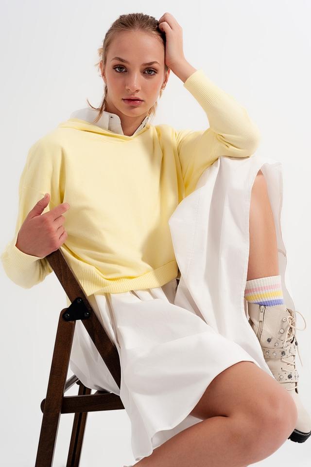 Camisola de manga longa amarelo com capuz