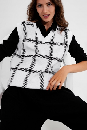Colete tricotado com grande traçado
